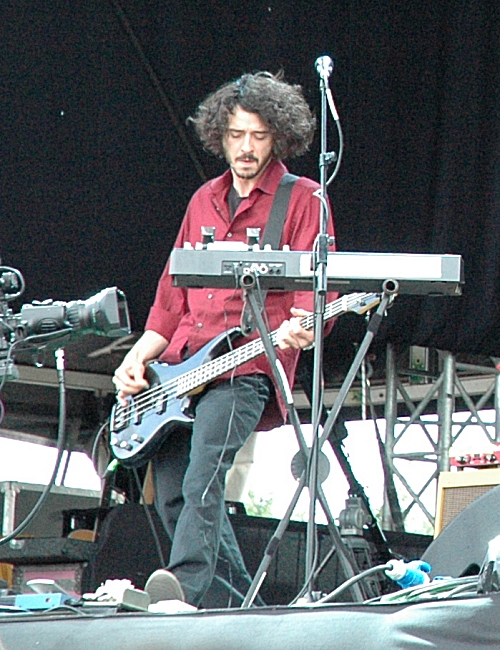 This is the bass guitar player for Guillemots, apparently his name is 'MC Lord Magrão'. Manchester (2008)