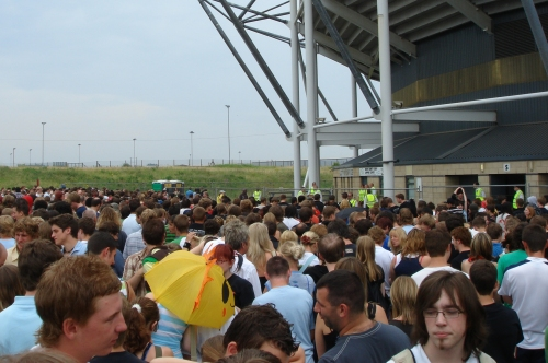 The crowd of mostly white teenagers wait for a long time to be let into the stadium, Derby (2006)